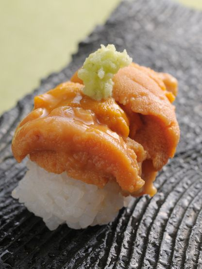 Classy style of Uni Nigiri, Sea Urchin Sushi.  Baiscally this is served with nori.but, at some high-class sushi restaurant in Japan, you could see this posh style.  #sushi