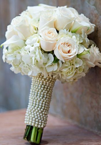 Handtied Style, aren't the Pearls lovely? They say 80% of all Brides choose a White and Green color palette--and this Bouquet has just 3 types of flowers in it. The Hydrangea frame the base of the bouquet and act like a pillow for the Roses and Stephanotis to sit on!