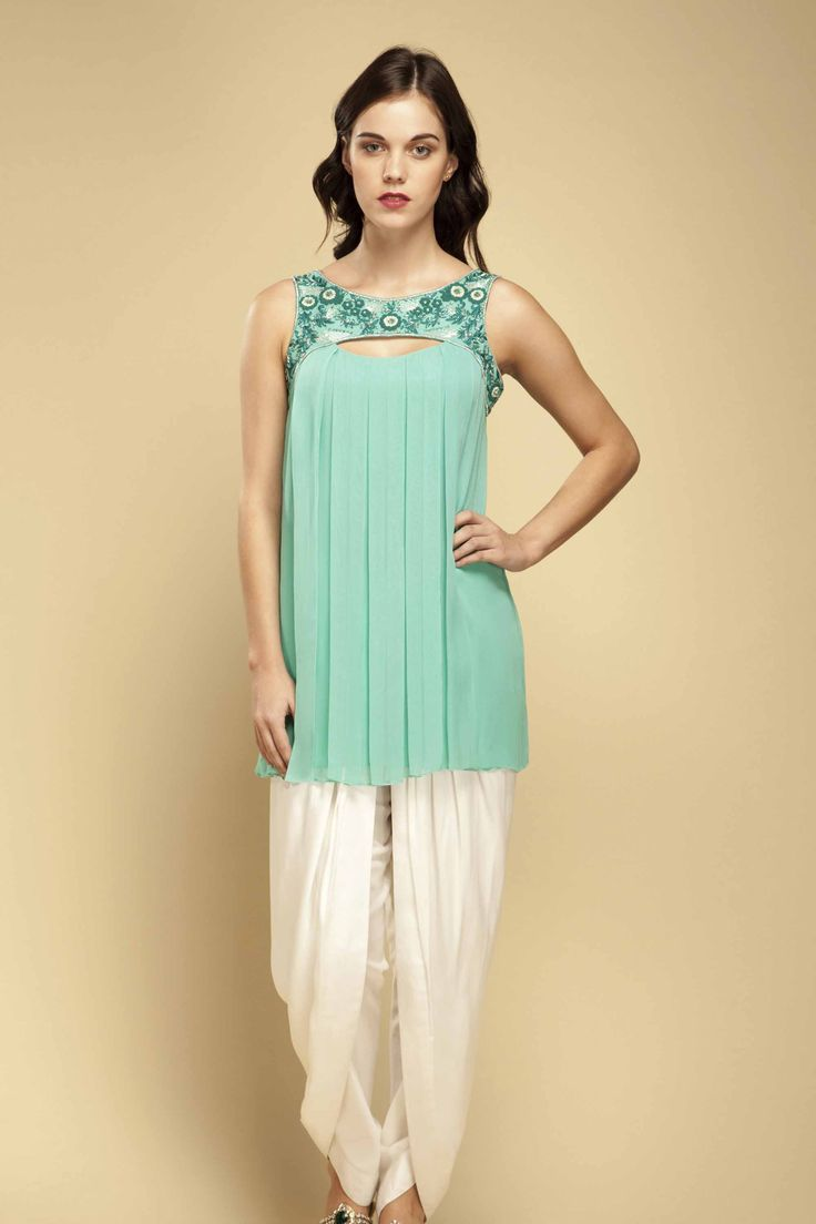 embroidered Bahama Green tunic teamed with white dhoti pants.
