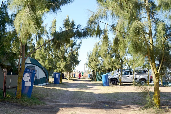 The 14 stand campsite with power outlets are on grass with trees for windbreaks and shade and hot showers in the ablution facilities cannot be closer to the water's edge with built fireplaces. Wood for the braai is sold on the farm.