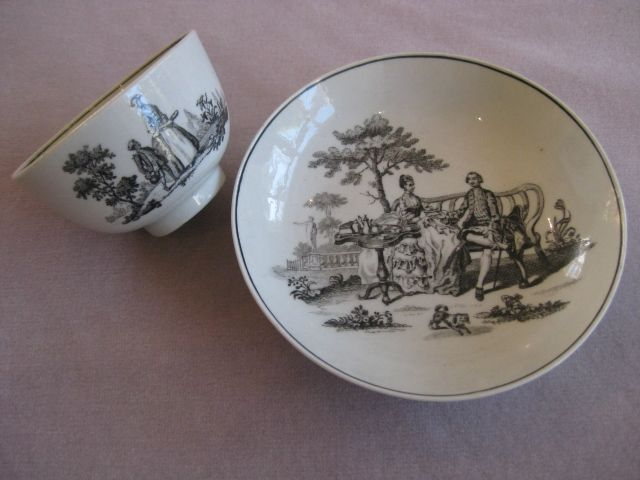 A Worcester tea bowl and saucer with Hancock prints of The Tea party no.2  and the Maid and Page to th bowl and the Tea Party no.2 to the saucer. Unamrked  Circa 1760