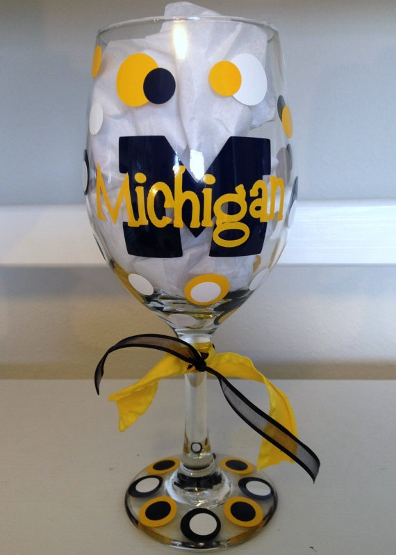 Wendy don't look at this if you ever go on pinterest. lol Possible gift someday. ;) University of Michigan Wine Glass by dottindivas on Etsy,