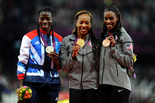 (L-R) Silver medalist Christine Ohuruogu of Great Britain, gold medalist Sanya Richards-Ross of the United States and bronze medalist DeeDee Trotter of the United States pose on the podium during the medal ceremony for the Women's 400m Final at London 2012 Olympic Games.