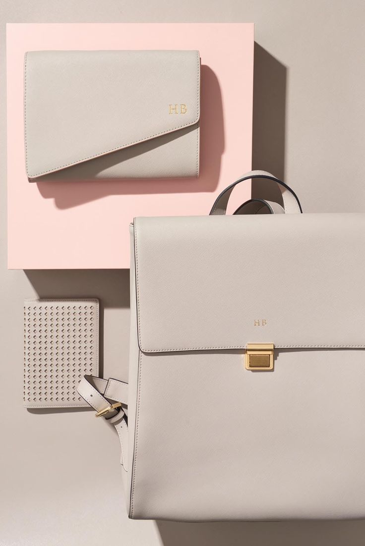 Pictured: The Daily Edited Asymmetric Clutch With Pale Pink Edge, The Daily Edited Large Backpack, The Daily Edited Perforated Passport Holder.