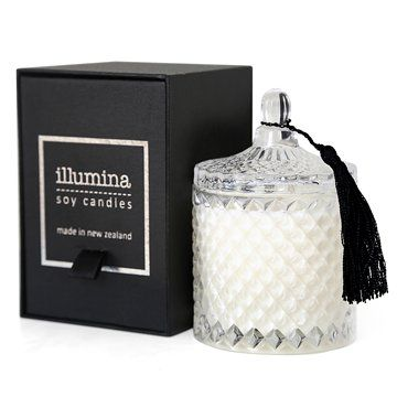 Illumina Scented Boudoir CandleLusciously scented soy candle housed in a cut glass lidded vessel embellished with a black tassel.Luxury reminiscent of a by-gone era.Burn time is approx. 45 hours.White Tea and GingerRelax with the warm soothing notes of ginger, nutmeg and musk. Peony and hyacinth add a subtle component to the top notes of lemon, bergamot and lily creating a gentle captivating fragrance.Botanical RoseRose lovers behold! Glorious garden rose interlaced with green