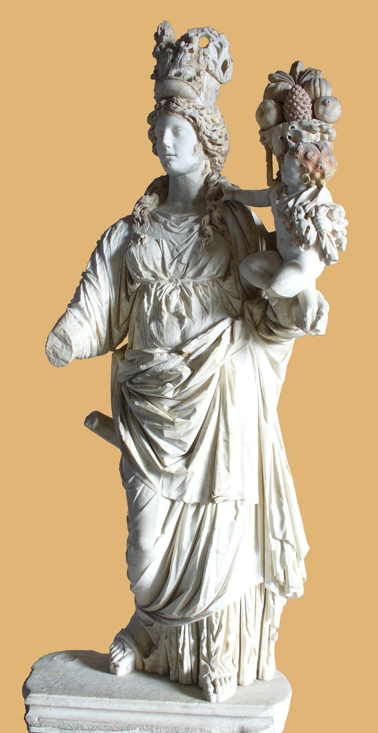 Istanbul Archaeological Museum - The goddess Tyche holding in her arms Plutus (god of wealth) as a child. Hellenistic art, Roman period, 2nd century AD. From Prusias ad Hypium (in the present-day il of Düzce). The coloring of the hair is remarkably well preserved.