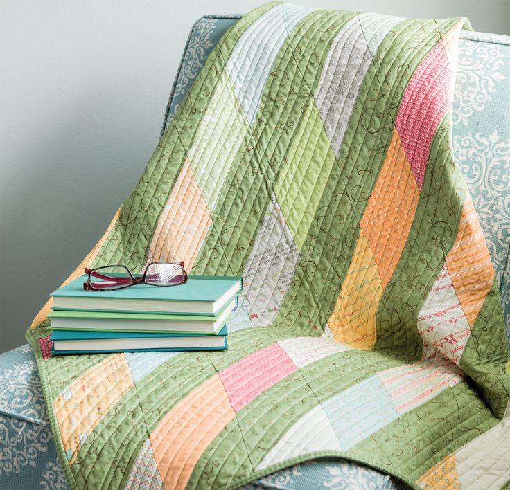 Who knew a simply pieced quilt could look so lively? Sew chunks of strips together to create this Diagonal Stripes quilt from the book Sew Charming.