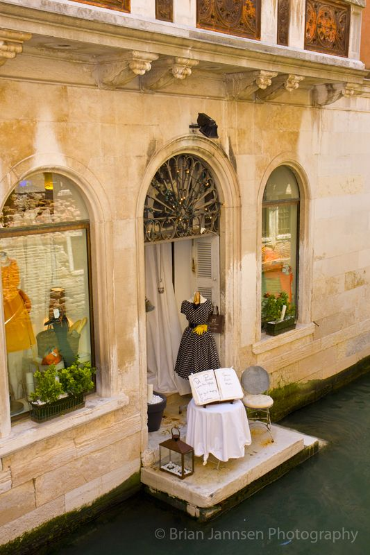 Store display along the canal, Venice, Italy.