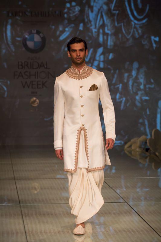 Tarun Tahiliani white and gold men's kurta with dhoti. More here: http://www.indianweddingsite.com/bmw-india-bridal-fashion-week-ibfw-2014-tarun-tahiliani-show/