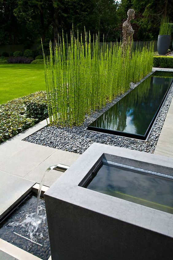 Modern infinity-edge water basins with a tiered fountain. www.ContainerWaterGardens.net