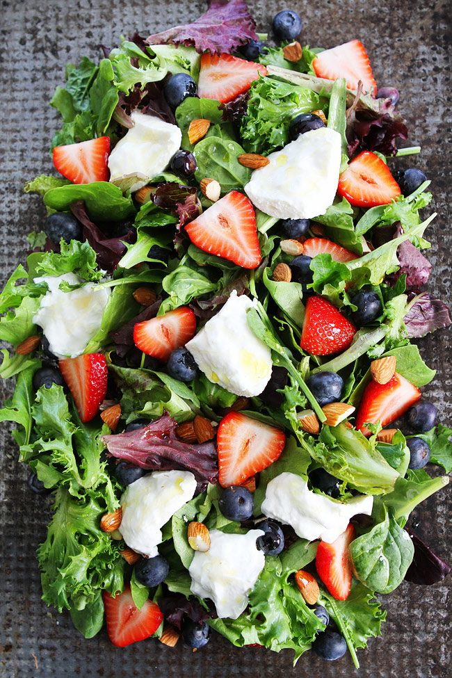 Berry, Burrata, and Almond Salad Recipe on twopeasandtheirpod.com Mixed greens topped with blueberries, strawberries,…