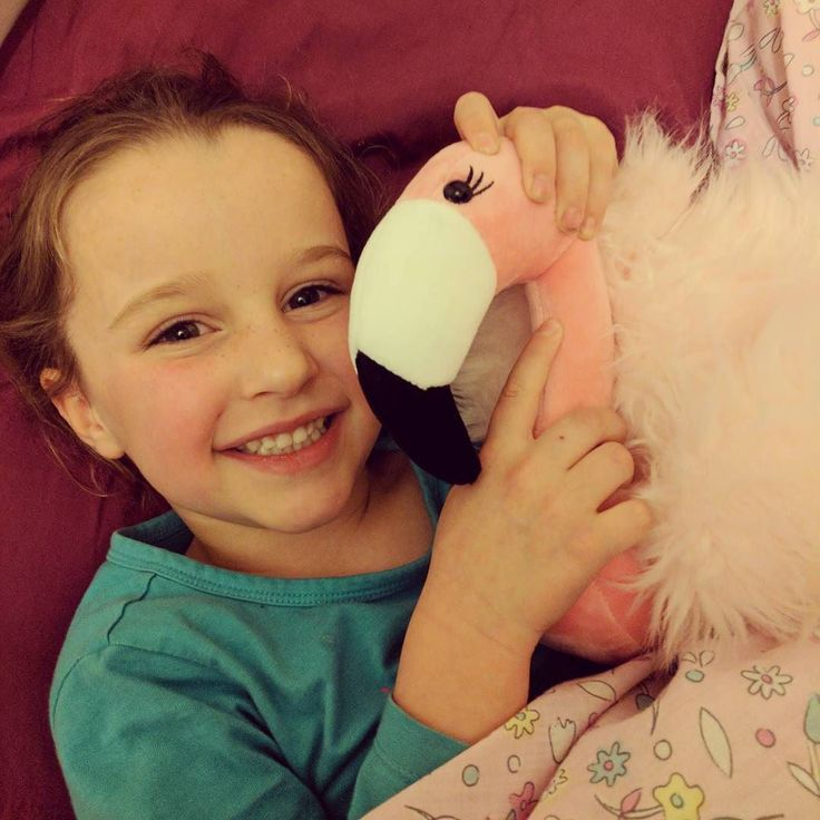 A girl and her beautiful new flamingo friend  The kids get so excited when a buddy sells out - it moves out of my kit and into their loving arms! #Scentsy #Buddy #ScentsWithChristie #ScentsyBuddy #Fun #Fragrance #Flamingo #Smiles #scentsykids