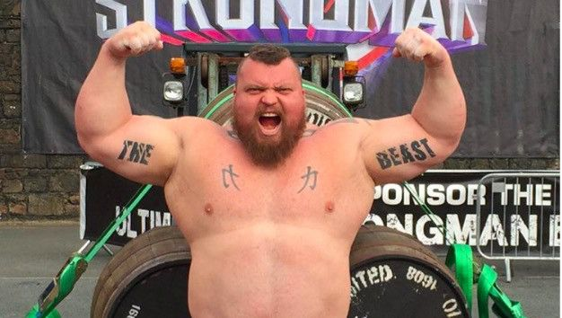 Strongman Eddie Hall Bench Pressing A Barbell With Two Grown Ass Men On Each Side Is Jaw-Dropping - http://viralfeels.com/strongman-eddie-hall-bench-pressing-a-barbell-with-two-grown-ass-men-on-each-side-is-jaw-dropping/