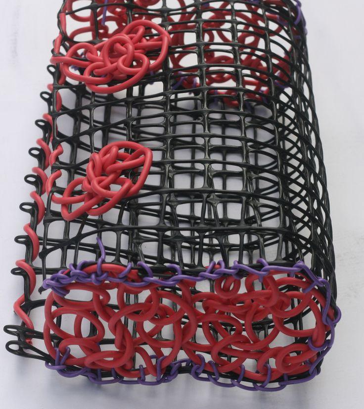 ©Maritza Noa-Cabrera.   Pink vintage inspired, handbag. Plastic and telephone cable wire.