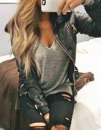 Olive leather jacket over gray tee with olive jeans.