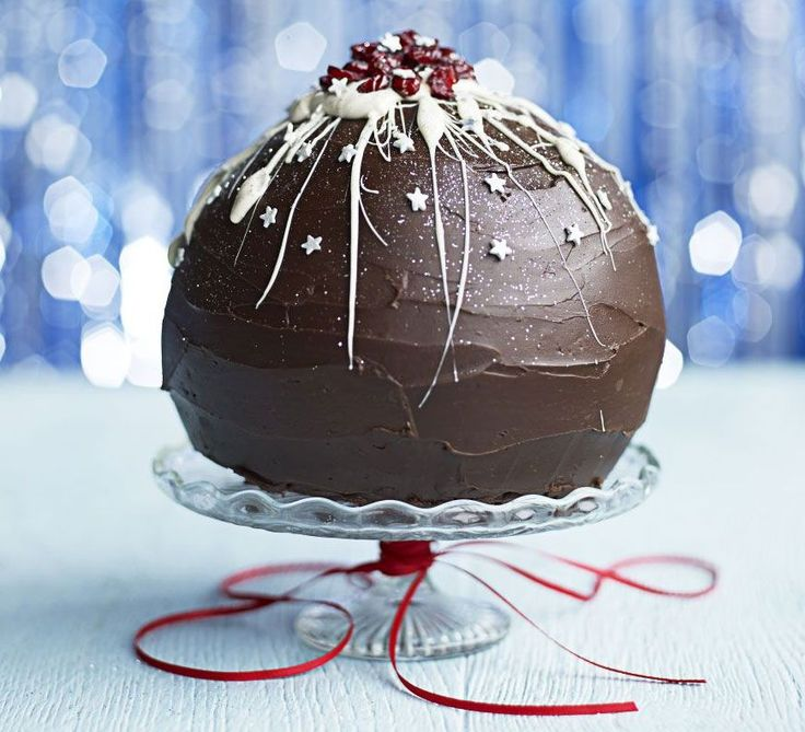 Chocolate orange & cranberry red velvet bombe. This stunning festive dessert makes a great alternative to Christmas pudding, with a hidden cream cheese and cranberry filling