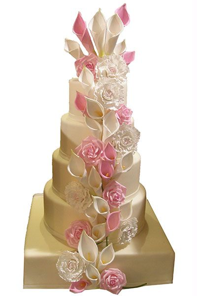 Sugar calla lilies, peonies, and roses cascade down the center of this wedding  cake ~ all edible