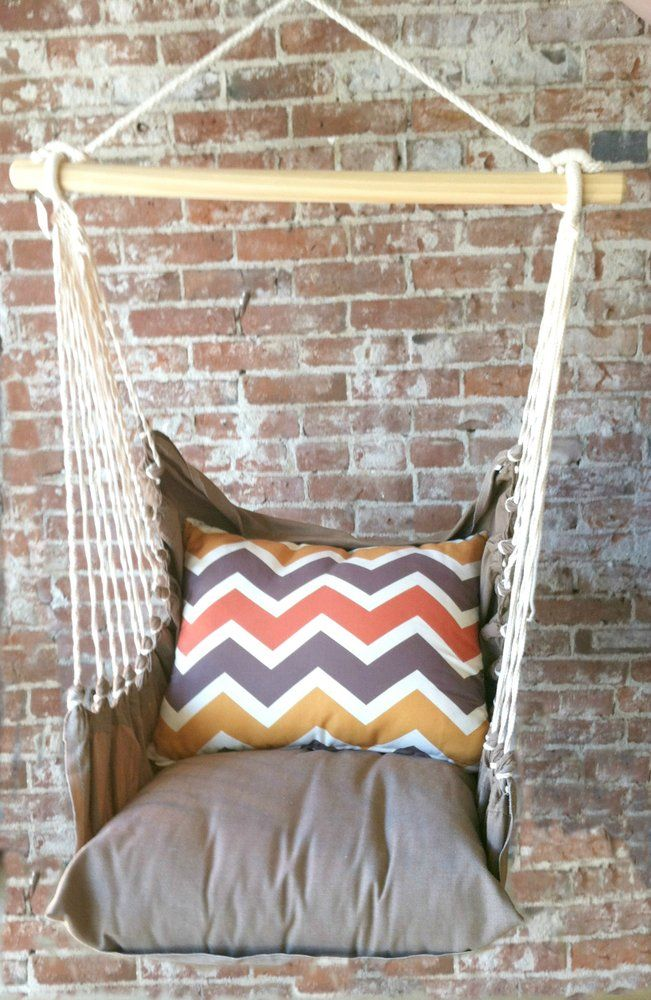 Relax in style in this comfy indoor/outdoor hammock swing chair. Includes an orange & brown Ikat print back pillow, brown seat pillow and brown...