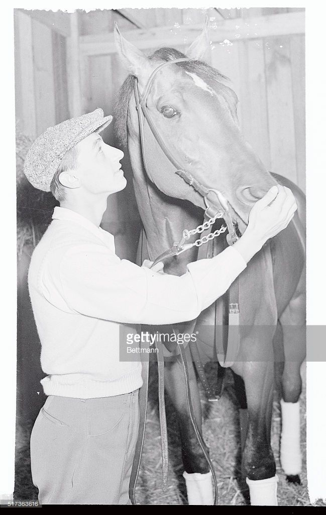 Jockey Eddie Arcaro is shown petting Devil Diver, Greentree Stable's entry in the Kentucky Derby. Arcaro is confident that Diver is good enough to walk off with the blue ribbon of the American turf at Churchill Downs tomorrow. Devil Diver will probably go to the post among the favorites.