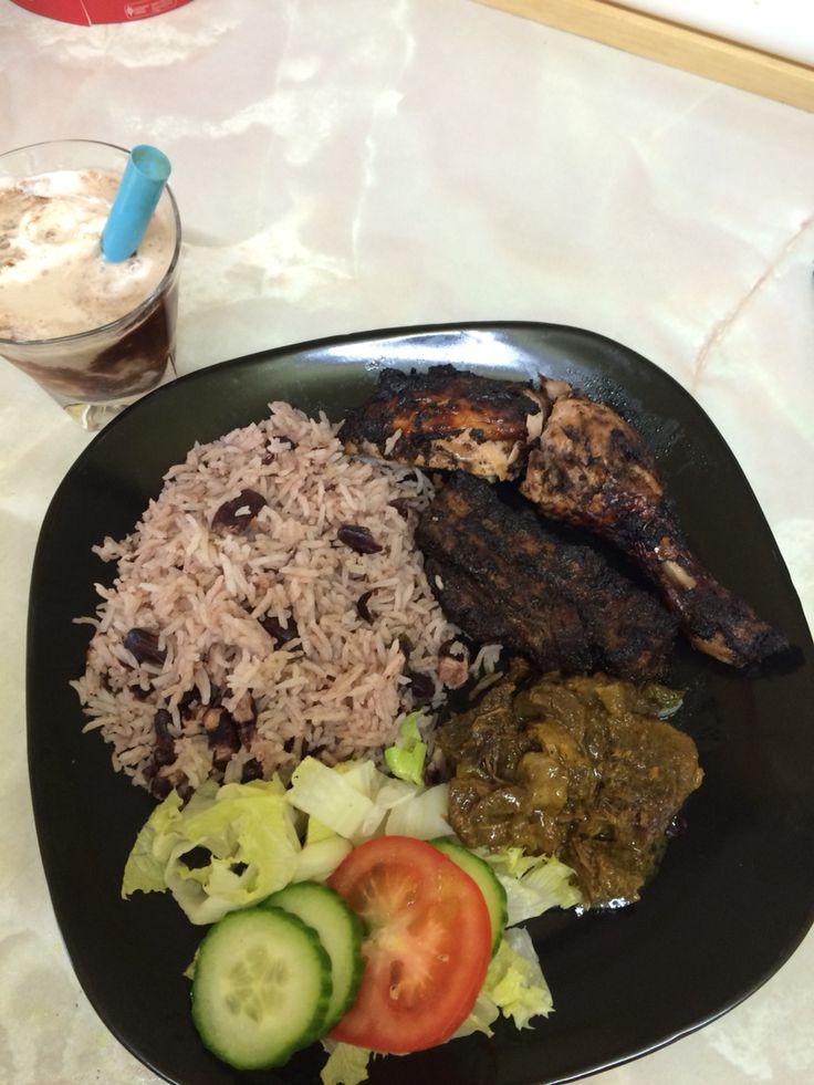 Jerk chicken , curry goat with rice and peas and salad (Jamaican dish )