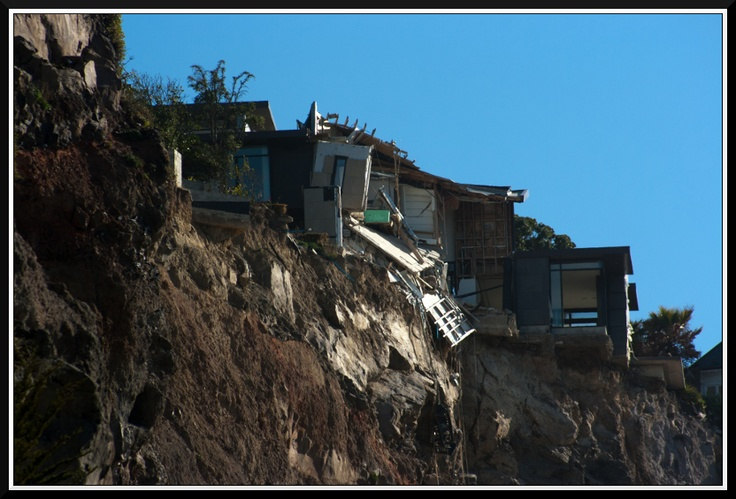 House hanging over the cliff in Sumner. More in this series to come. — at Sumner, Christchurch, New Zealand.