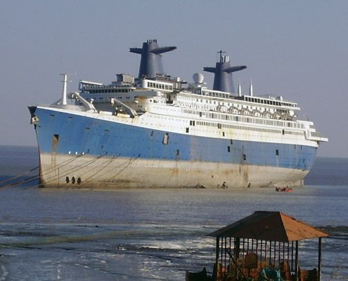 Once the pride of France, the SS France sits on the beach awaiting its turn at the ship breakers. Old ocean liners are too small and slow to be profitable and end up being broken up for cold rolled steel, something that is needed all over Asia.