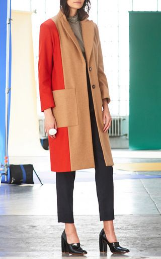 This **Whit** Rothko merino wool coat features a notch lapel and a long boxy silhouette with front patch pockets.