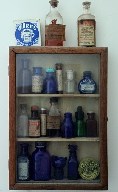 vintage bottles  Everyone collected blue bottles, didn't they?  Blue glass warded off evil spirits in the garden!