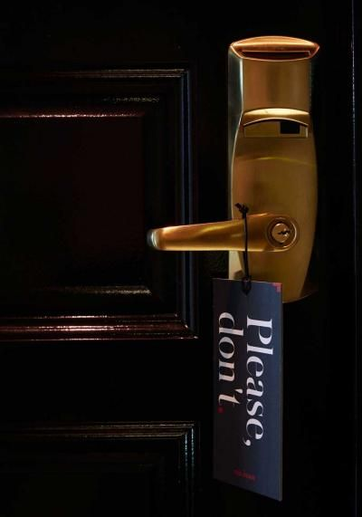 'please, don't' do not disturb sign // The Dean Hotel
