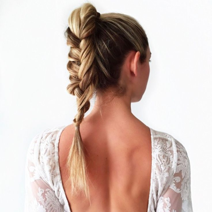 Braided high ponytail + backless white blouse. Pose from @caramcleay
