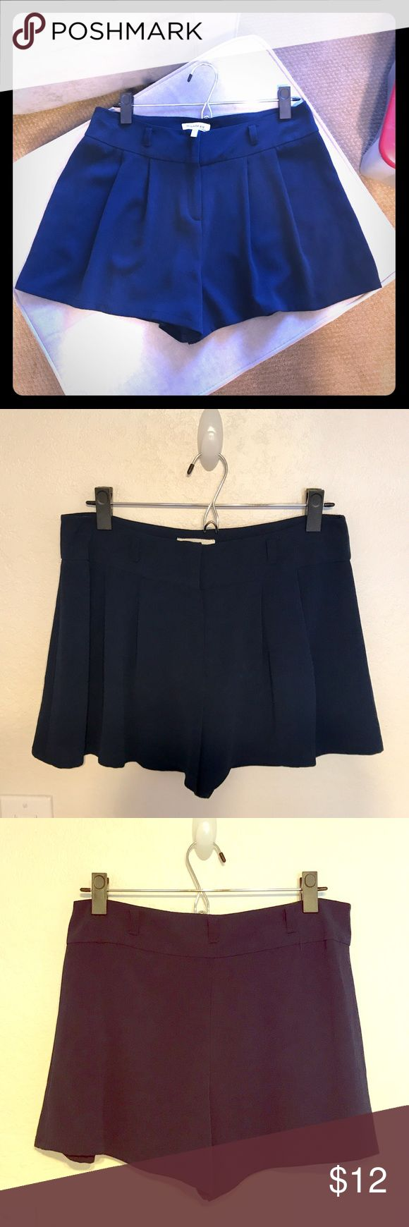 Flowey shorts Cute high waisted shorts. Light dress pants like material. This can totally be worn with leggings and a top tucked in for a more dressed up look or with just a crop top for a more casual look! Navy blue color Monteau Shorts Skorts