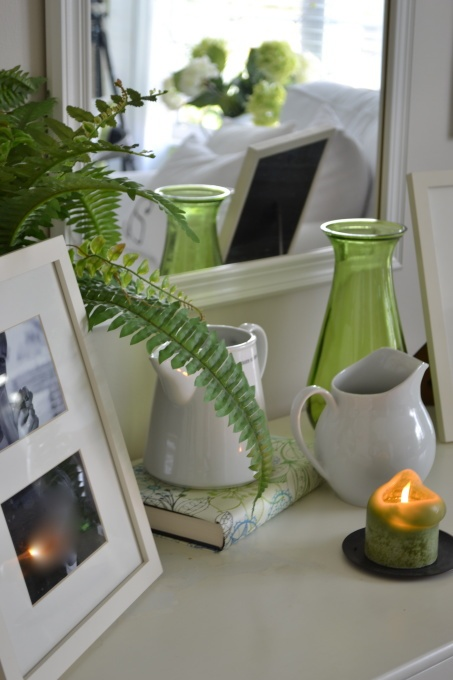 guest room.  love the touches of green with the map covered book.