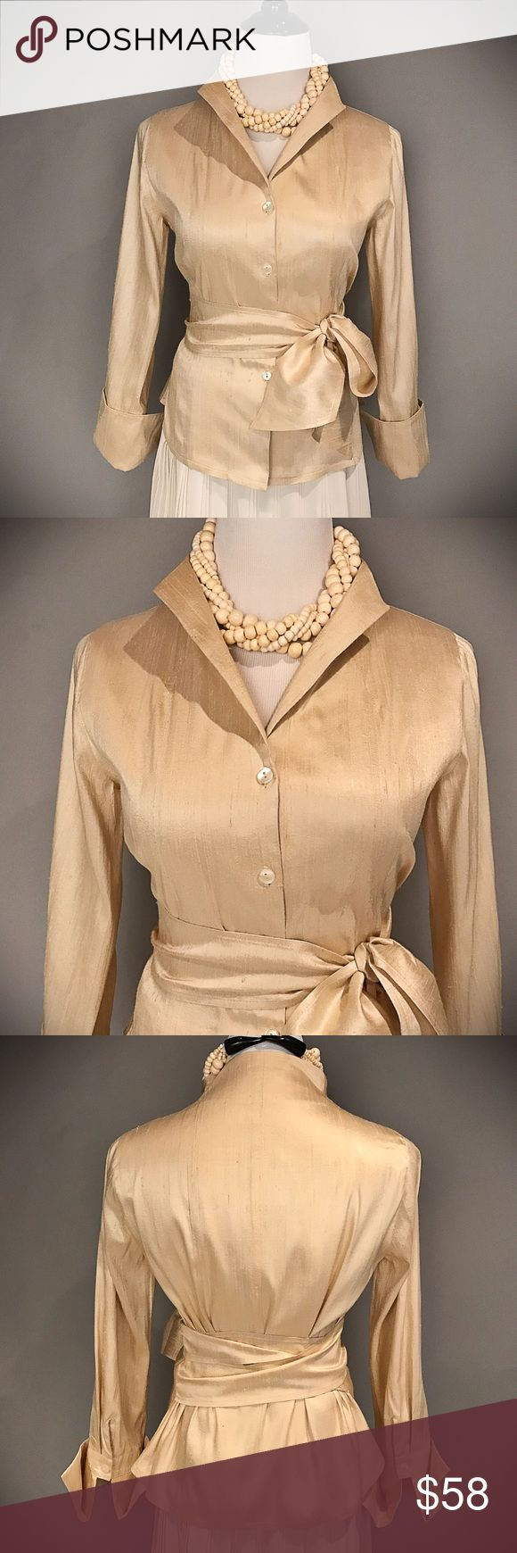 """Silk Dupioni Anni Kuan Blouse Stunning butter cream tone Blouse by designer Anni Kuan.  """"Anni's design sensibilities have earned her a devoted following amongst women with a distinct sense of accomplishment, and includes celebrities like Laura Linney, Nicole Kidman, Joan Allen, and New York's first lady Chirlane McCray."""". This lovely Blouse has 3/4 French cuffs, a beautiful detailed neckline and an attached wide sash to wrap at the waistline.  Worn once and in pristine condition. Shoulder to…"""
