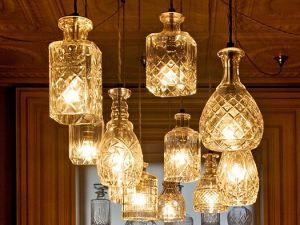 Pendant lights from old whiskey decanters.