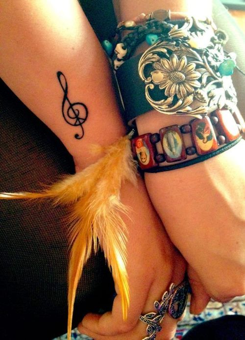 Amazing peace and music tattoo. Love the placement of it too.