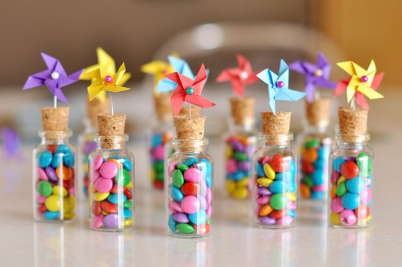 These are so cute! You take a tiny glass jar, full it with chocolate covered sunflower seeds, and cork it off. Then, you make a tiny pinwheel, and attach it with a slightly bent sewing pin!