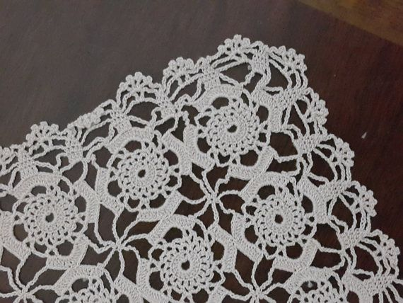 Check out this item in my Etsy shop https://www.etsy.com/listing/251591814/vintage-lace-doile-cream-ecru-table
