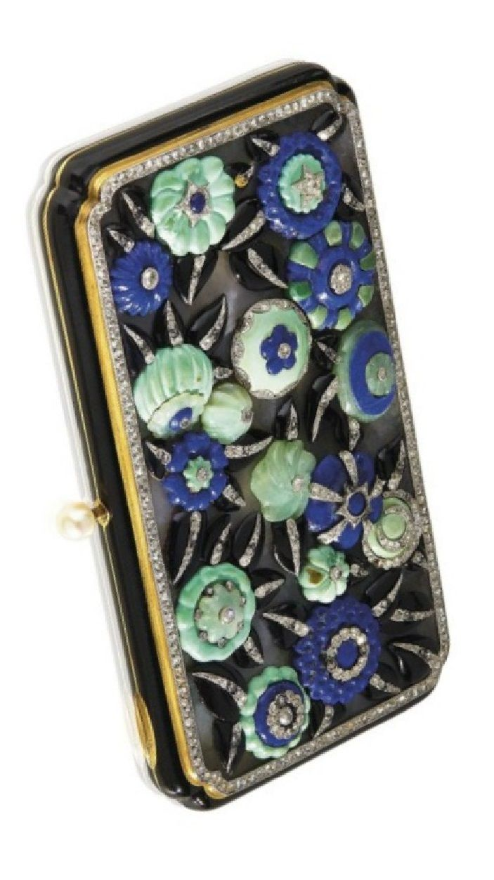 LACLOCHE FRÈRES - AN ART DECO GEM-SET VANITY CASE, CIRCA 1925. The rectangular quartz cover applied with various flowerheads set with turquoise, onyx, sodalite, quartz and diamond, within a rose-cut diamond surround, to the black enamel case and pearl push piece, with French assay marks for gold and UK import marks, signed Lacloche Frères Paris, numbered, with maker's mark for Strauss, Allard & Meyer.