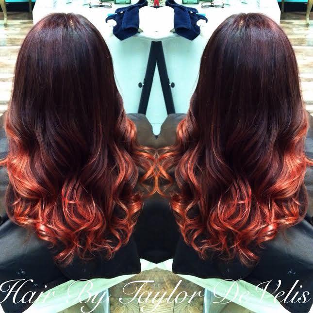 Stunning balayage ombre using reds and pinks