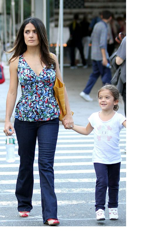Salma in casual v-neck blouse and jeans with daughter