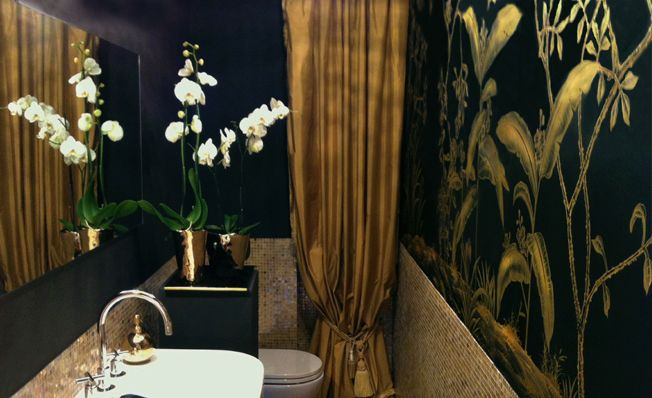 Bathroom wall in Misha's modern chinoiserie, Gold Banana Garden wallpaper design on Black dyed silk.