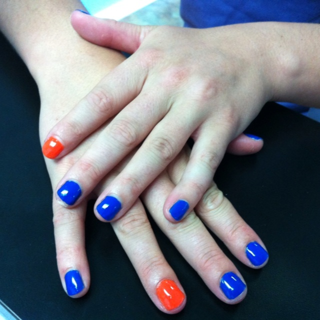Go Gators! ...or your favorite team. Let us help you show your spirit with team insured nails.