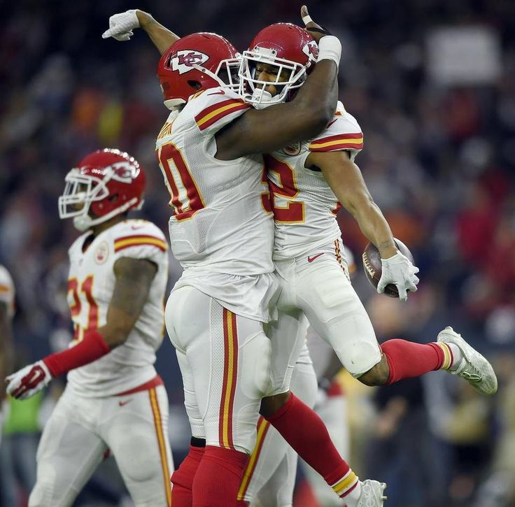 Kansas City Chiefs cornerback Marcus Peters (22) celebrates with outside linebacker Justin Houston (50) after Peters picked off a pass late in the second quarter during the AFC wild card game on Saturday, January 9, 2016 NRG Stadium in Houston.