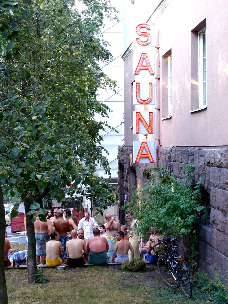 Men relax inside — and outside of — this sauna in Helsinki.