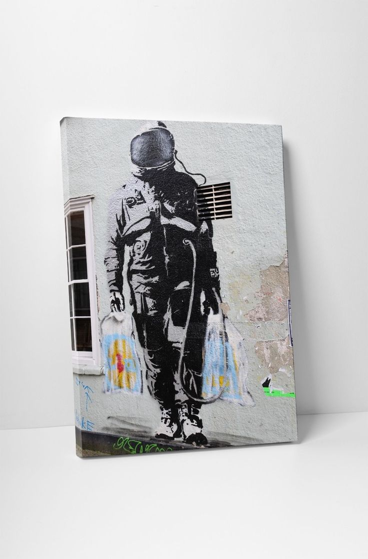 Banksy Shopping Astronaut Gallery Wrapped Canvas Print. Bonus Banksy Wall Decal!