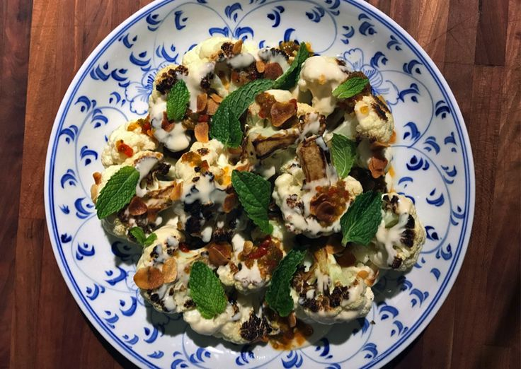 Charred Cauliflower with tahini vinaigrette with hot pepper jelly, crispy garlic, and mint.