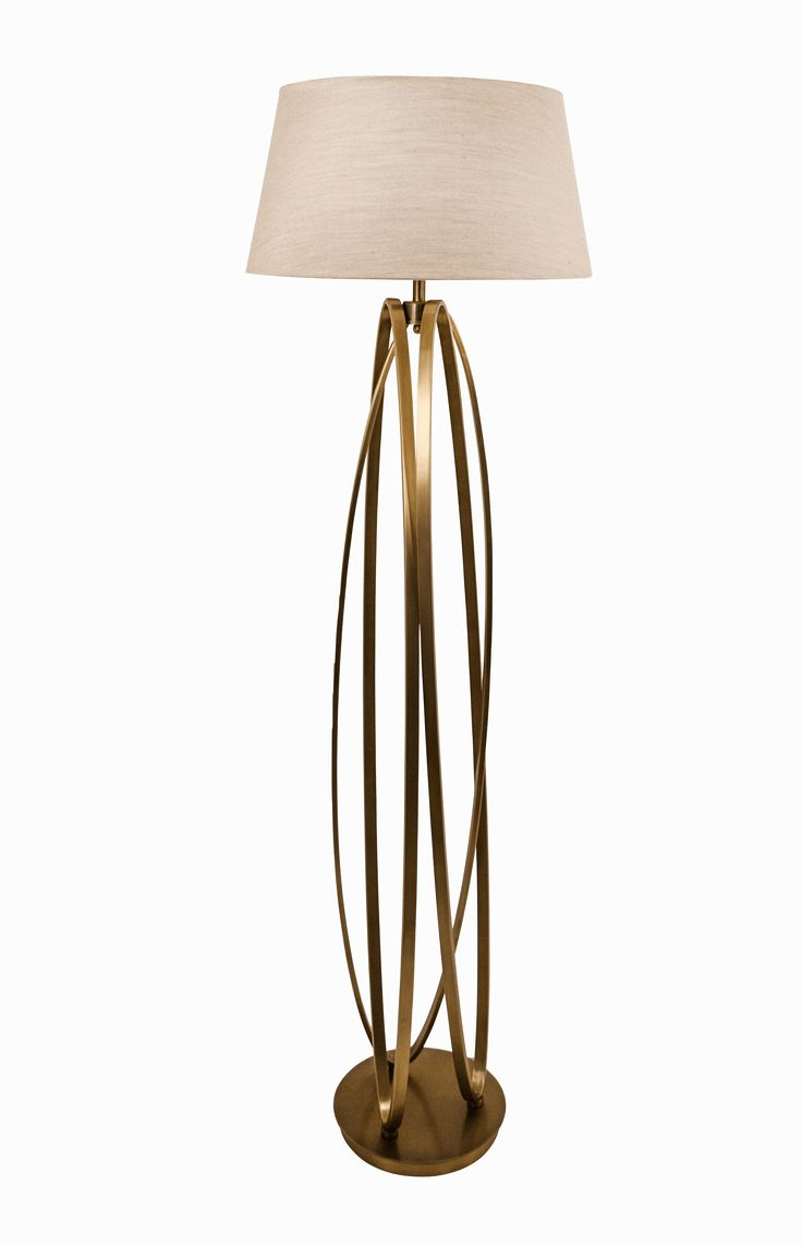 The Brisa Antique Brass Floor Lamp by RV Astley boasts a frame finish in bronze/brass, with a brown light shade. Part of the Brisa range, this beautiful floor lamp is the perfect compliment to a minimalist living room.