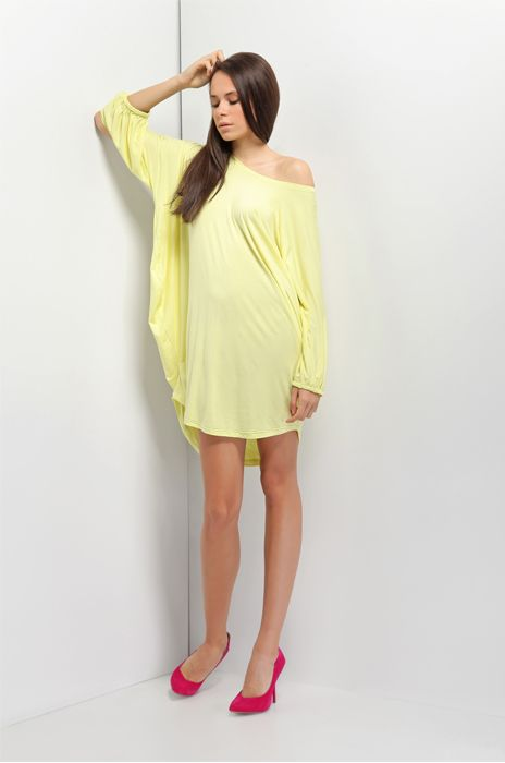 Comfortable tunic with cuts on the sleeves. Yellow tint is ideal for everyday.