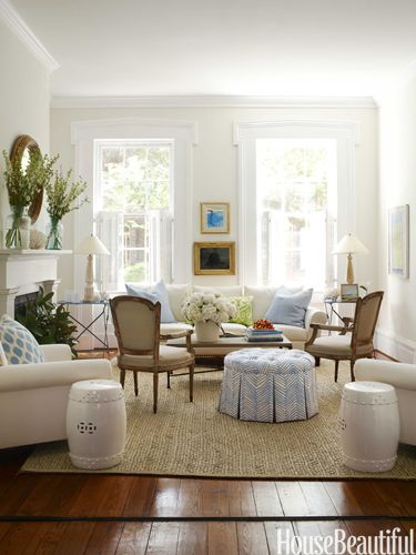 White living room. Creamy white walls and very white trim with timber