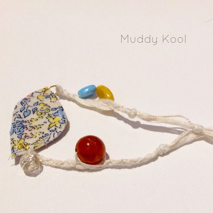 Handmade Floral bird Upcycled fabric charm on a tie up cotton bracelet with recycled beads..made for the little girl who like FANCY..